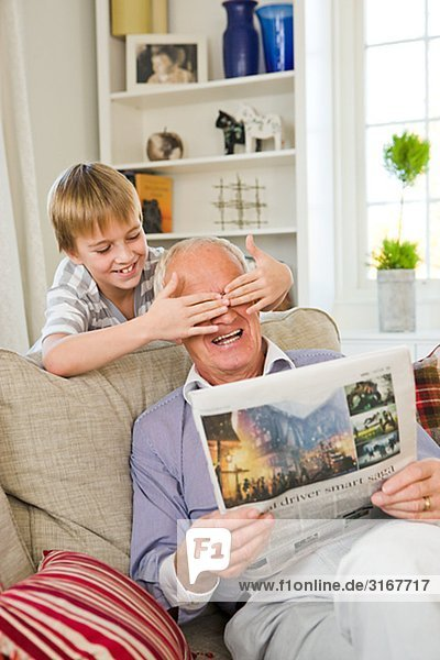 Grandfather and grandson in a sofa  Sweden.