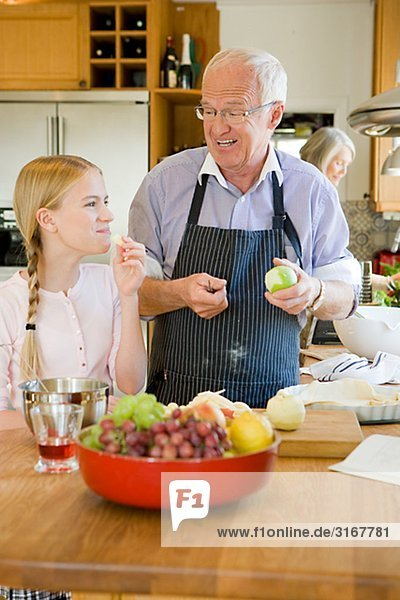 Senior couple baking with their granddaughter  Sweden.