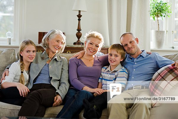 Multi-generation family sitting in a sofa  Sweden.