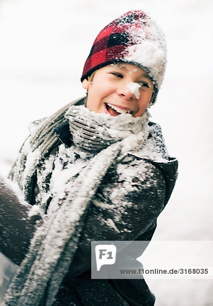 Portrait of a boy covered in snow  Sweden.