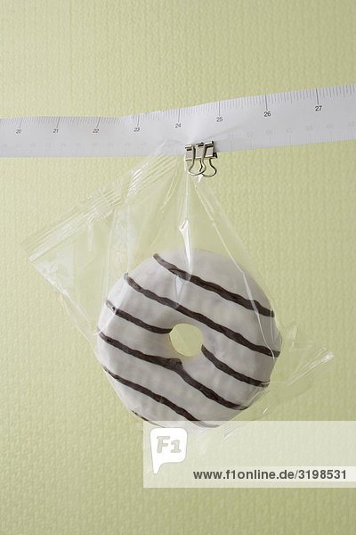 donut hanging on tape measure