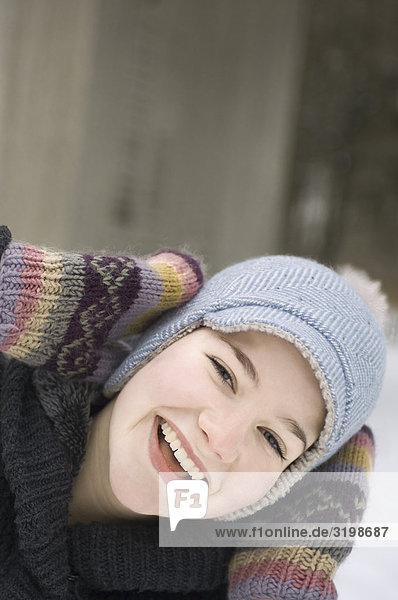 headshot of teenage girl in winter