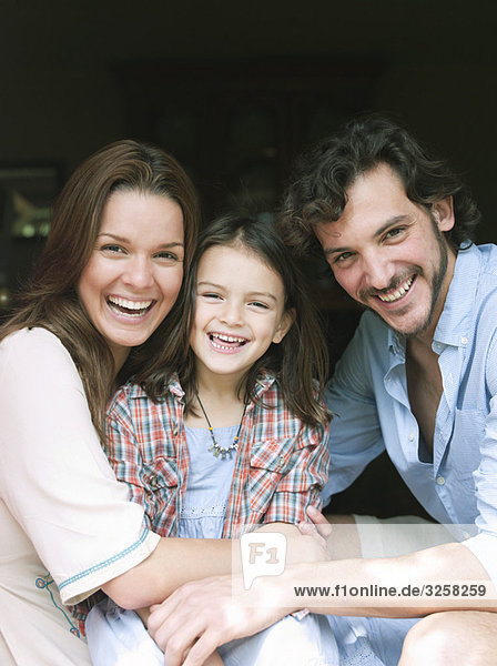 Family laughing together in house