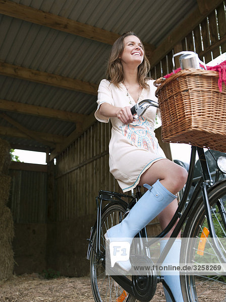 Woman in on bike with picnic basket