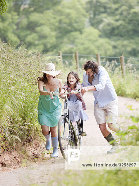 Family with daughter on bicycle