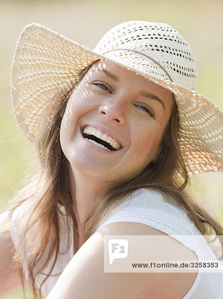 woman in hat smiling eyes closed