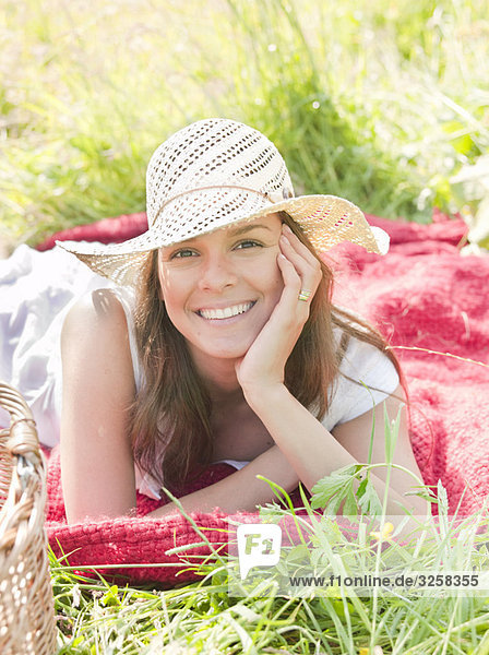 woman in hat smiling