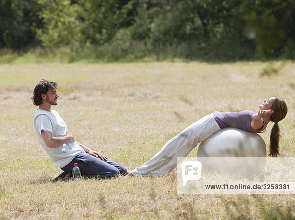 couple with yoga ball stretching