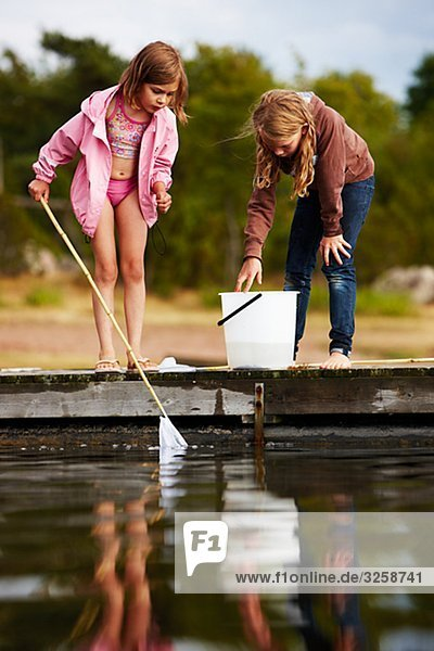 Two girls fishing  Sweden.