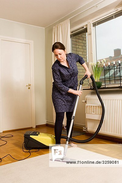 A woman vacuuming  Sweden.