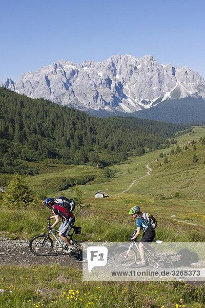 Italy  Dolomites  Couple mountainbiking  elevated view