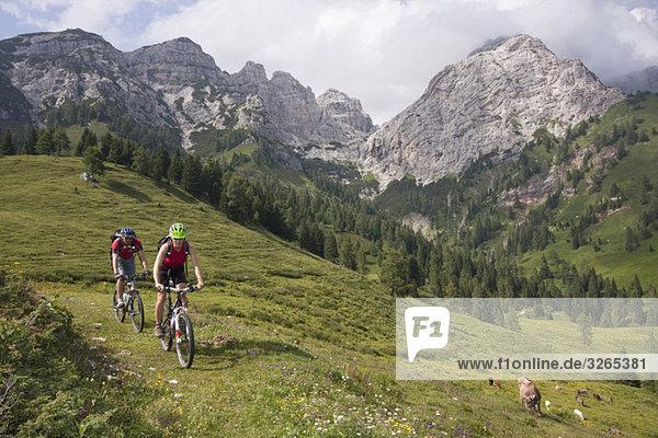 Italy  Dolomites  Couple mountainbiking