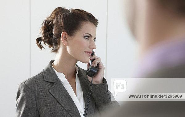 Businesswoman using phone  looking away