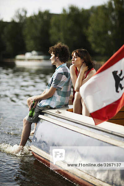 Germany  Berlin  Young couple on motor boat