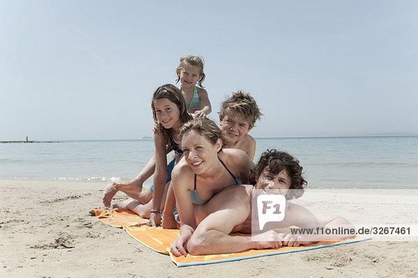 Spain  Mallorca  Family lying on beach