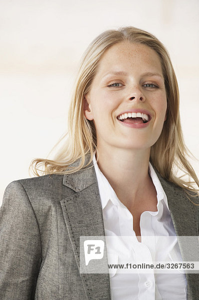 Young businesswoman laughing  portrait