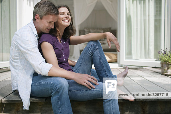 Germany  Hamburg  Couple sitting on terrace