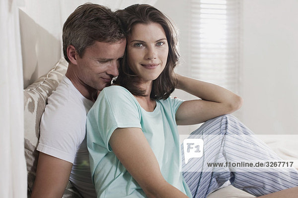 Germany  Hamburg  Couple sitting in bedroom