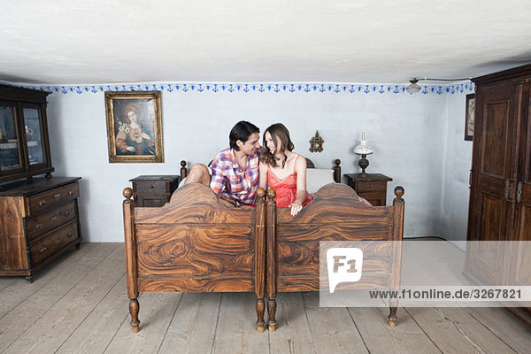 Germany  Bavaria  Young couple in rural bedroom