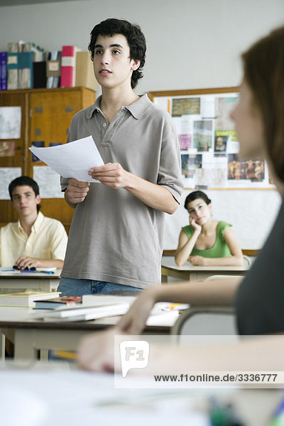 High school student reading report to class
