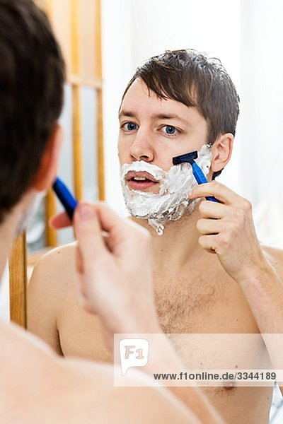 Young man in front of a mirror.