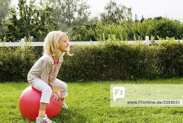 Girl playing in garden