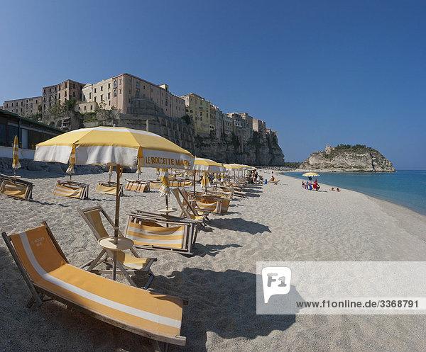 10867748  Tropea  Calabria  Mediterranean  Italy  village  beach  seashore  sand  sand beach  deck chairs  sunshades  tourism  holidays