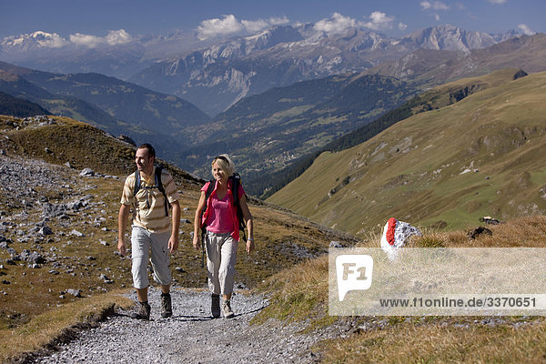 10874049  Switzerland  swiss  autumn  walk  hike  two  pair  couple  Strelapass  Davos  mountains  canton Graubunden  Grisons  Bundnerland  persons  Schanfigg  footpath  scenery