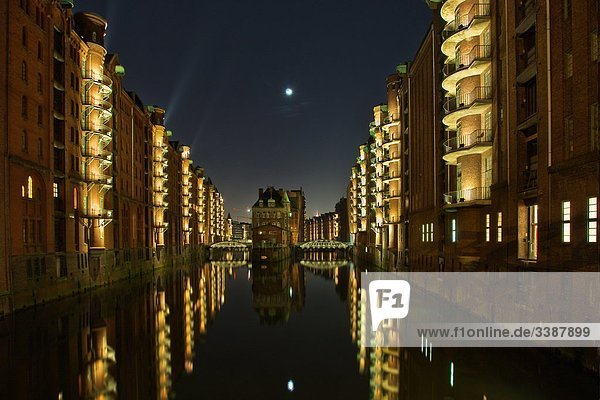 Illuminated houses in the old warehouse district (Speicherstadt)  Hamburg  Germany