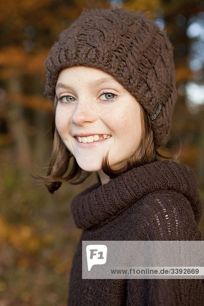 Girl with brown beanie and pullover