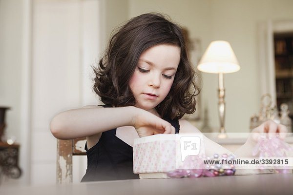 girl exploring contents of parcel
