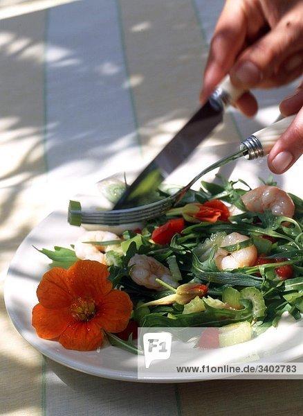 Scampi salad with a nasturtium blossom