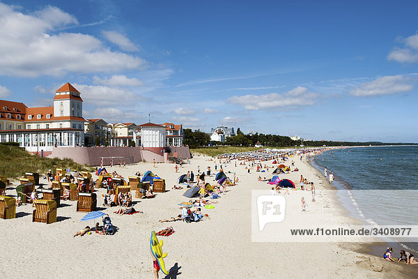 Tourists on the beach of Binz  spa hotel in the background  Ruegen  Germany  elevated view