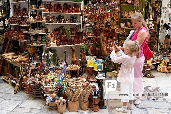 Mother and daughter shop for toys and souvenirs Kerkyra old town  Corfu  Greece