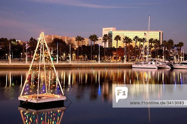 Marina and floating Chirstmas Tree in the evening  Shoreline Village  Long Beach  California  USA