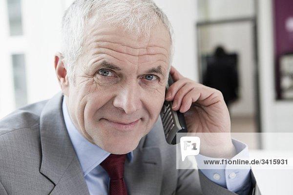 Phoning man looking at camera