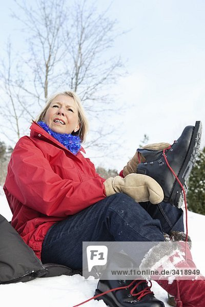Woman changing shoes outdoors