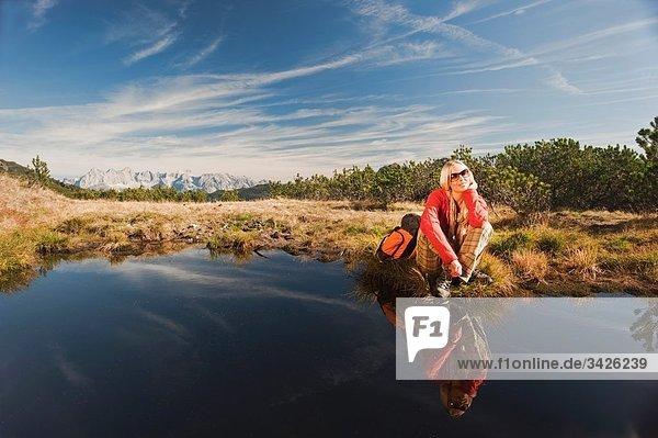 Austria  Salzburger Land  Woman relaxing by lake