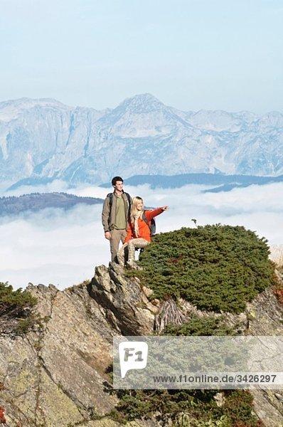 Austria  Steiermark  Reiteralm  Hikers in mountains  woman pointing