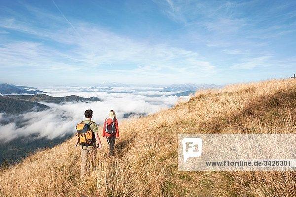 Austria  Steiermark  Reiteralm  Couple hiking  rear view