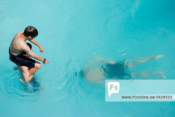 Boys playing in swimming pool  Auckland
