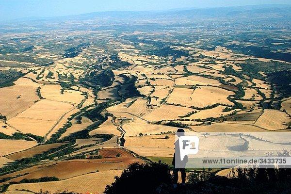 Man climbing up to Lapoblación peak  Navarra