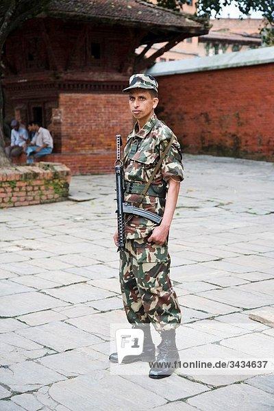 A police officer in the town of Bhaktapur near Kathmandu Nepal