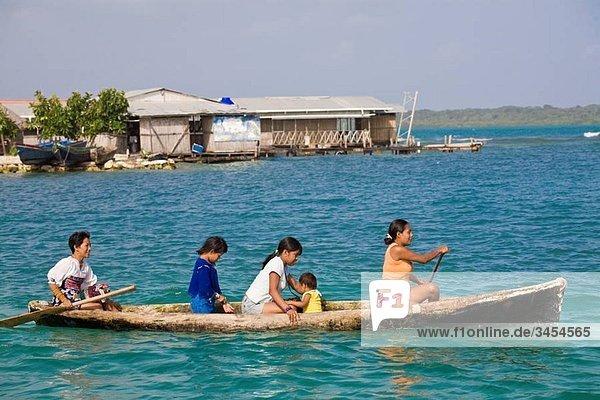 Kuna Indians in dug out canoe  Wichub-Wala Island  San Blas Islands  Kuna Yala  Panama