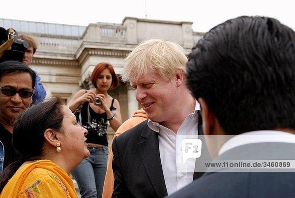 Mayor of London Boris Johnson talking to an Indian woman at the Vaisakhi Sikh New Year Festival in Trafalgar Square  London  England