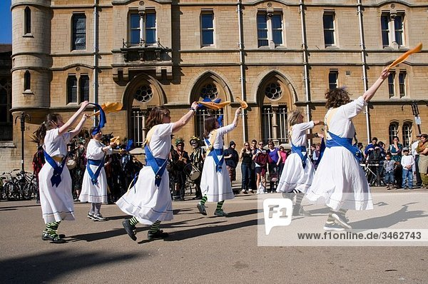 Morris dancers in action at the Oxford Folk Festival  dancing on Broad Street in front of Balliol college