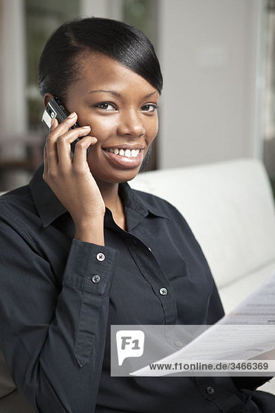 A businesswoman using a mobile phone