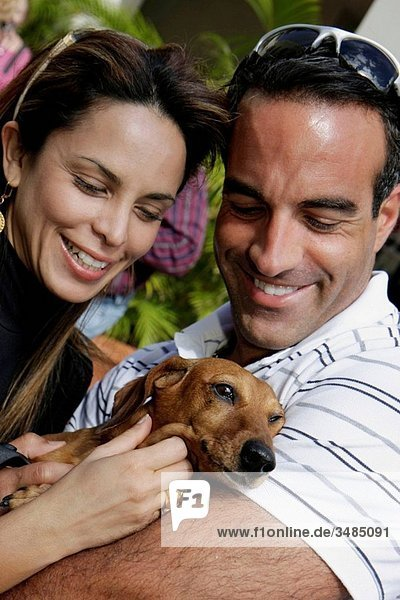 Florida  Miami  Temple Israel  Bow_Wow Palooza Interfaith Blessing of the Animals  owner  pet  dog  animal  man  woman  couple  family  attractive  smiling  Dachshund  petting  smiling  affection  happiness