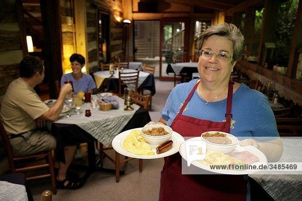 Virginia  Steeles Tavern  near Blue Ridge Parkway  Sugar Tree Inn  Bed and Breakfast  lodging  dining room  innkeeper  woman  man  couple  breakfast  plates  food  omelet  service