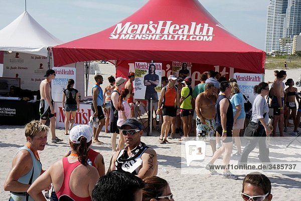 Florida  Miami Beach  Nautica South Beach Triathlon  Atlantic Ocean  shore  sport  fitness  post race  sponsor  tent  men´s health  magazine  marketing  socializing  man  woman  athletes  celebrate  exhibitor